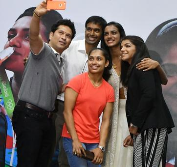 PHOTOS: Sindhu, Sakshi, Dipa, Gopichand presented swanky BMW