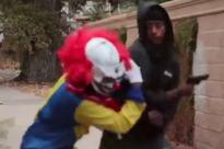 'Killer clown' pistol whipped by furious gun owner who keeps telling prankster 'that's not funny&#039