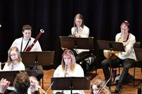 Musical youth play with orchestra