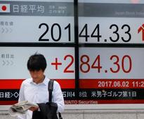 Asia stocks pressured as Wall St hit by healthcare vote delay