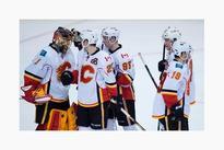 Jonas Hiller makes 34 saves as Calgary Flames down Vancouver Canucks 4-1