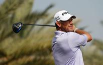Westwood leading in Dubai despite his caddie's absence