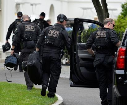 Armed man outside White House refuses to stop, shot at