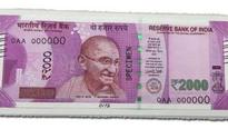 Only Rs 2,000 notes, debit cap land many in quandary