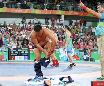Wrestling: Furious Mongolians strip off over bronze medal defeat