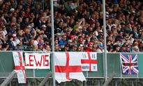 Hamilton on pole for Mercedes at Silverstone Fans of Mercedes' Lewis Hamilton during qualifying. (Reuters / Andrew Bo...