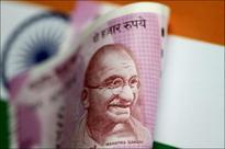 India eyes extra $ 7.7 billion spending to halt economic slowdown: govt sources