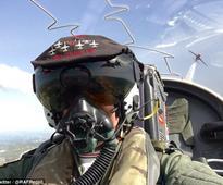 Red Arrows video shows cockpit view of jet rocketing above stunning Greek coastline
