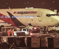 Passengers aboard Malaysia Airlines jet hail pilot as hero