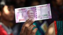 What to do when youve damaged a precious Rs 2,000 note? This Mumbai man is trying to find out
