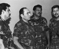 El Salvador arrests 4 ex-soldiers in massacre of Jesuits