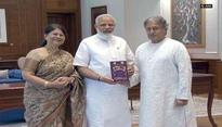 Ustad Amjad Ali Khan meets PM Modi, presents his book