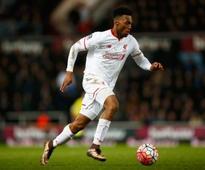 Michael Owen urges Liverpool to clarify future of star striker
