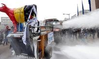 Farmers Protesting EU Policy Spray Milk Powder on EU Council HQs in Brussels