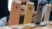 How much does an iPhone cost around the world, in hours?