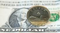 Loonie nears three-week high as investors tempered greenback bets amid release of Fed minutes