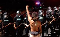 North Carolina: Protesters take to streets after police shoots black man in Charlotte