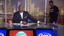 NBA rookie stumbles onto live TV set while checking phone