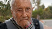 He is 102, works for a Perth's Edith Cowan university, and wants to keep his job