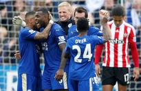 Leicester goes 7 points clear at top by beatin... Leicester City's Danny Simpson, Wes Morgan, Kasper Schmeichel, Christian...