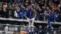 Baez plays hero with 8th-inning home run, Cubs beat Giants in Game 1