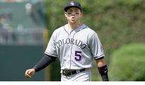 Rockies planning to work out Carlos...