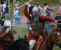 Medieval Warriors Cross Swords at Times and Epochs Festival in Moscow