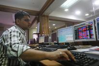 Sensex rises; Tata Motors rallies
