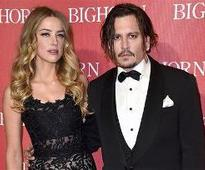 Depp loses cool in fight with Amber Heard