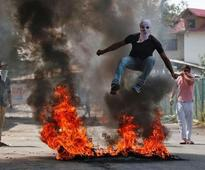 Curfew, protests mar Muslim holy day for families in Indian Kashmir