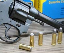 Four arrested with six firearms and live cartridges