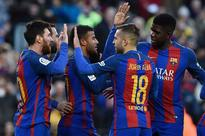 Luis Suarez, Lionel Messi keep Barcelona on Real Madrid's tail
