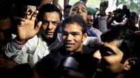Dope-tainted Narsingh's father protests in front of Narendra Modi's office, demands 'high-level' probe