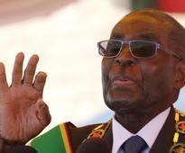 Zimbabwe's Mugabe rejects ill health talk but faces rising public anger