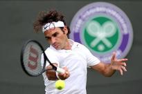 Federer shows no mercy to Wimbledon no-hoper