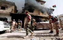 Libyan forces advance in Sirte, 14 troops killed, officials say