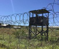Report: Feds Outsourcing Gitmo Trials