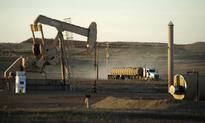 Oil prices fall on surprise build in U.S. crude stocks