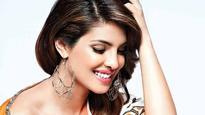 CHECK PICS: Priyanka Chopra making summer statements already as she touches down in Mumbai!