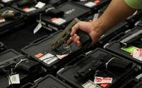 US congress scraps Obama rules on on background checks for gun ownership