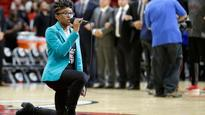 Heat national anthem singer takes knee