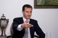 Syria's Assad says Erdogan imposing Islamist agenda after coup