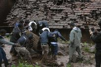 Pune landslide: Rescuers battle rain in search victims