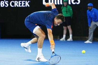 PHOTOS: Vintage Federer hammers Berdych to reach Aus Open last 16