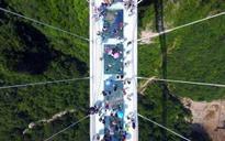 World's highest glass bridge opens in China