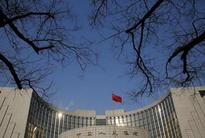 China's central bank cautious on zero rates as growth 'decent': Yi Gang