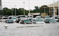 Automaker shares rise as Texans must replace drowned cars