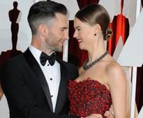 Adam Levine and wife battling over their daughters first word