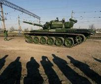 Russian troops, tanks pour into Ukraine