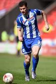 Wigan clinch promotion to Championship after victory at Blackpool